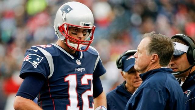 Belichick (r) with Tom Brady.