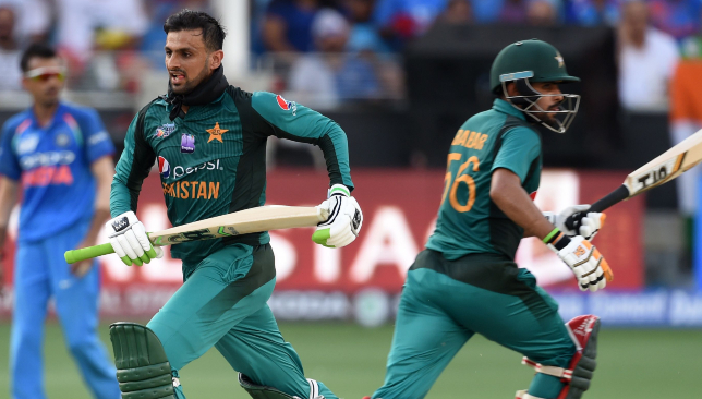 Shoaib Malik (l) was run out.
