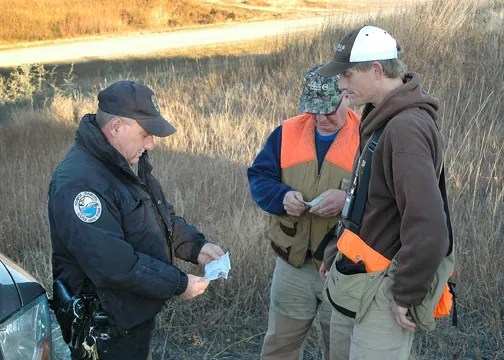 010113Game warden checking  hunters