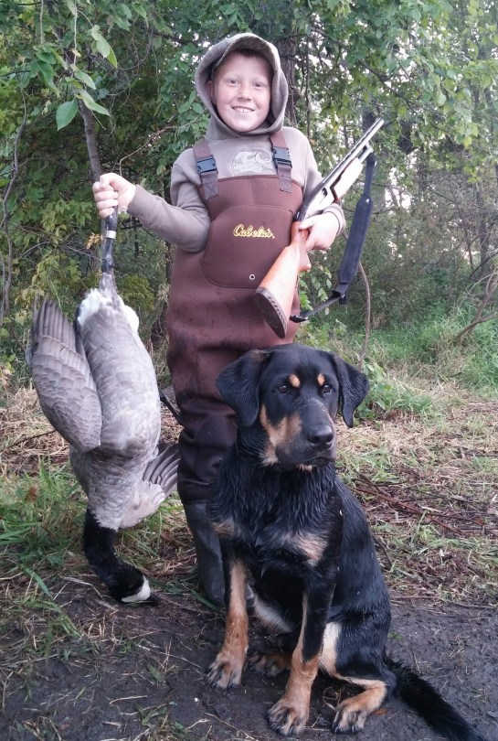Kenneth McKinley 8 yrs old second goose also with 20g which was banded and 7 month old lab Amos with his second retrive on a goose!