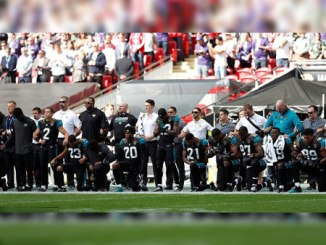 BREAKING: American football stars drop to their knees during national anthem at Wembley