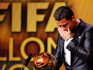 Ronaldo with the Ballon d'Or