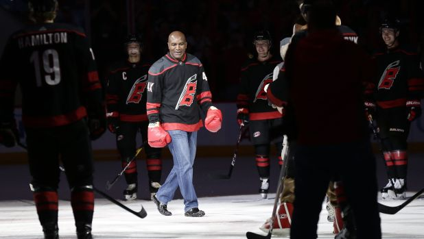 Evander Holyfield 'knocks out' Martinook in Hurricanes' latest Storm Surge — ProHockeyTalk