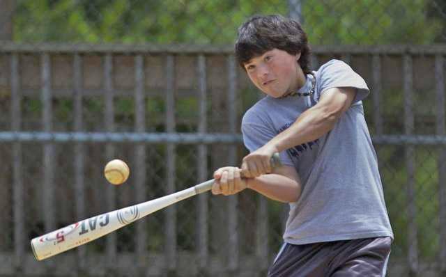 Matthew Migliaccio, now 13, takes BP at the Manchester Little League complex. (Photo: Asbury Park Press)
