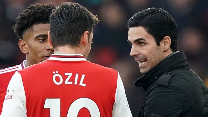 Arsenal title winner Paul Merson has called on manager Mikel Arteta to apologise to Mesut Ozil.