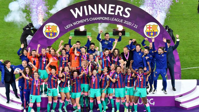 Barcelona lift the trophy after winning the UEFA Women's Champions League final against Chelsea