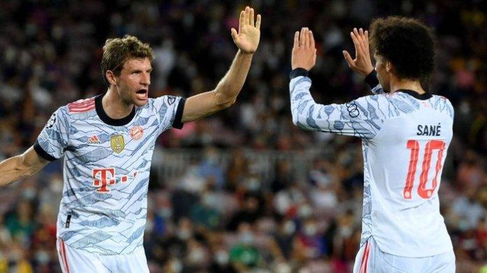 Muller celebrates with Sane