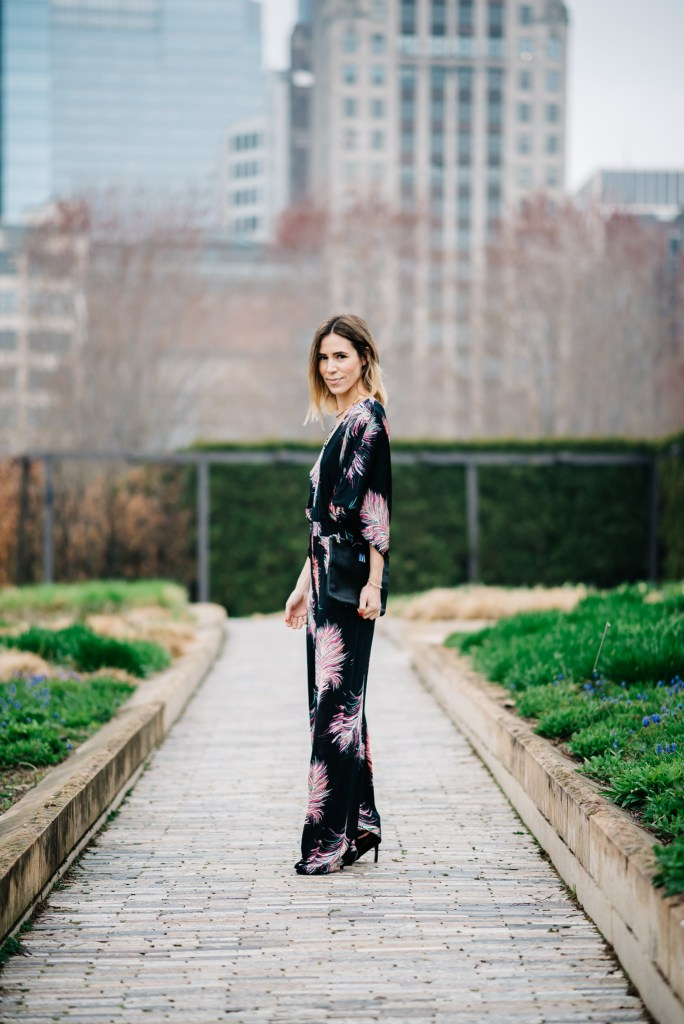 Krishna Black Sula Jumpsuit, Black lace-up sandals, monogrammed clutch, Chicago fashion blogger, fashion and sports