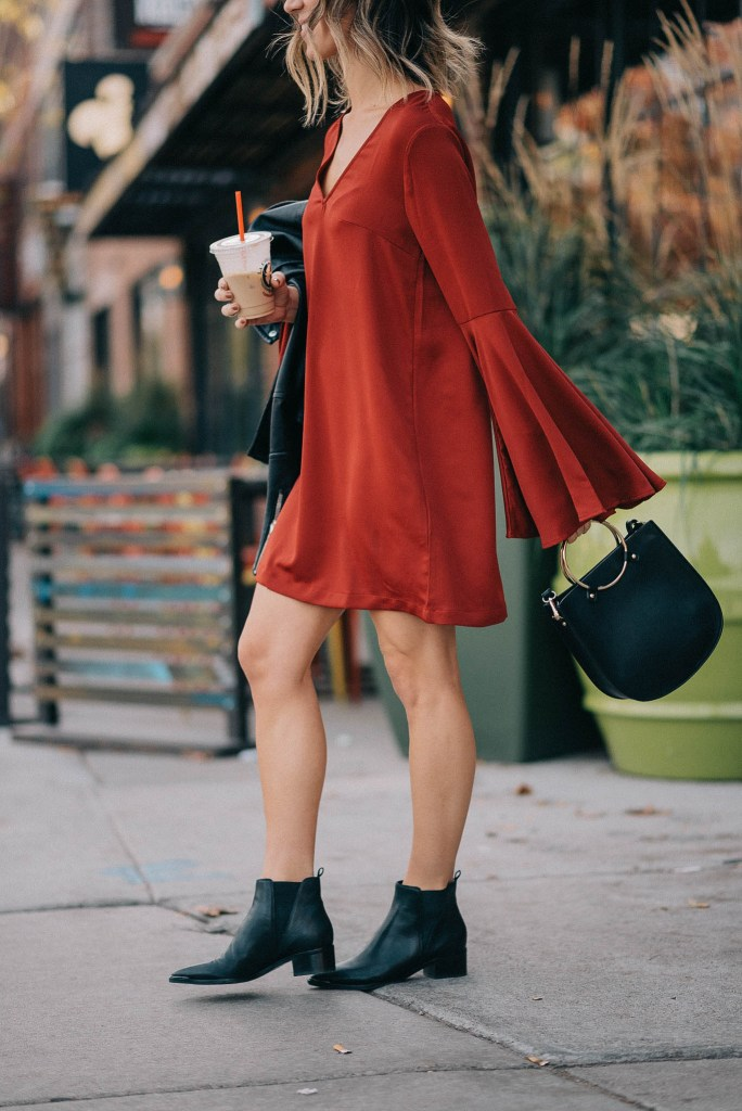 Holiday fashion and red dress with sleeves