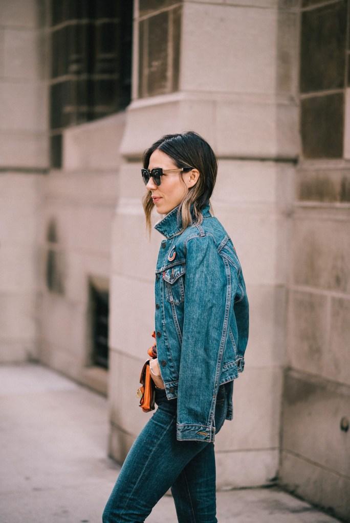 Blogger mary krosnjar wearing a Chicago Bears denim Levis jacket