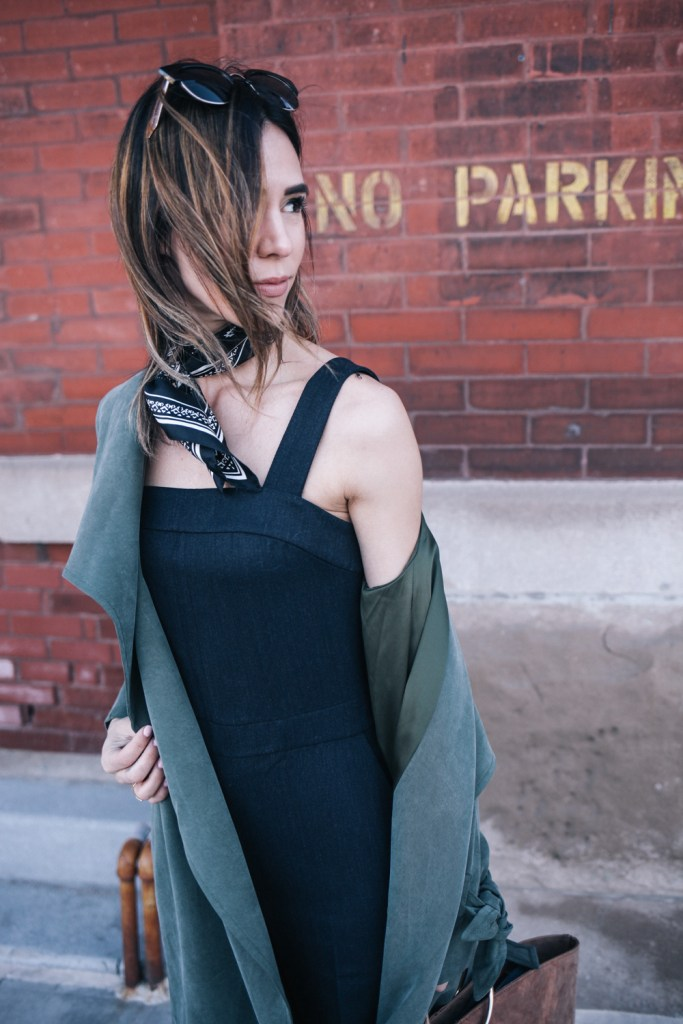 Blogger Mary Krosnjar wearing Club Monaco Jumpsuit and draped trench coat