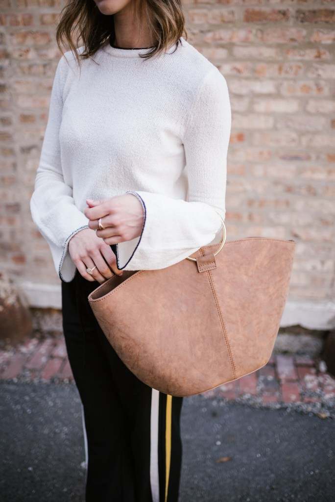 Blogger Mary Krosnjar wearing Who What Wear Suede Tote and Track Pants