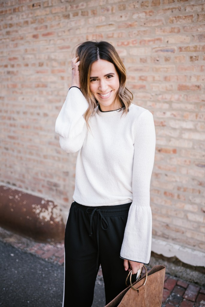Blogger Mary Krosnjar wearing Who What Wear Bell Sleeve top and Track Pants