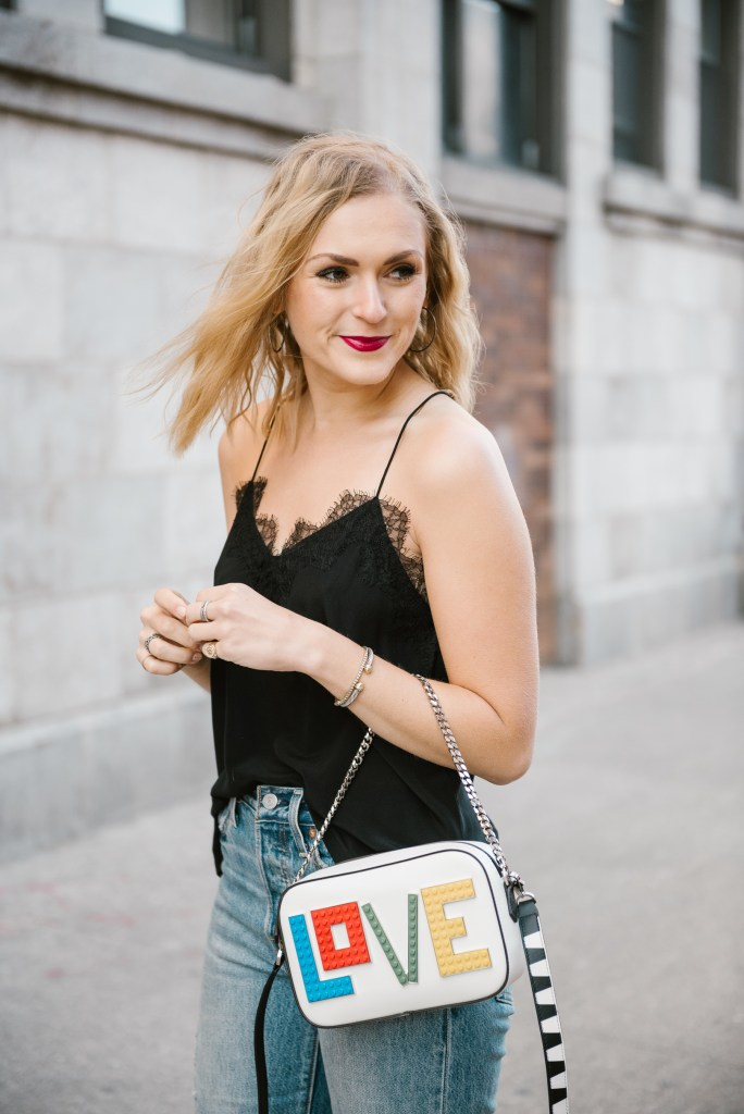 Blogger Ali Stone wearing NYC Cami and Exclusive Roy Black Widow Love Bag