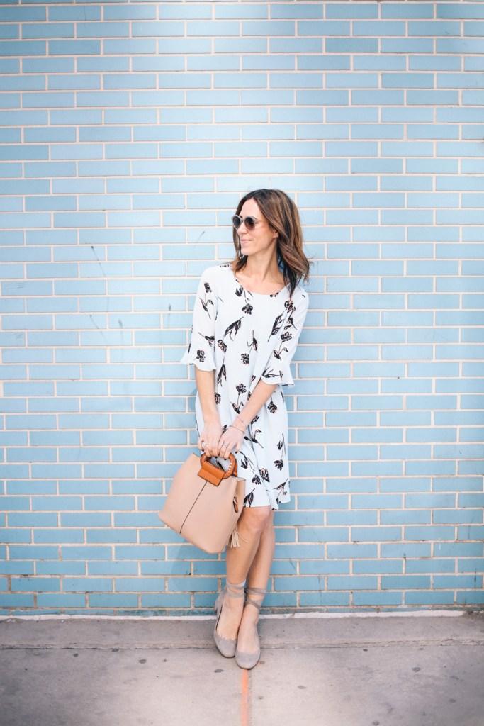 Blogger mary krosnjar wearing flora dress and Charles David grey suede block heels