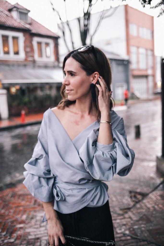 Blogger Mary Krosnjar wearing Tasseled Woven Clutch and Ruffle Sleeved Top