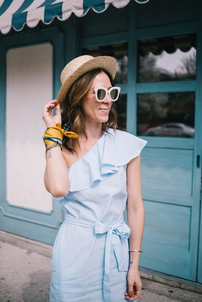 Blogger Mary krosnjar wearing Sole Society straw hat and One Shoulder Mini Dress with Belt
