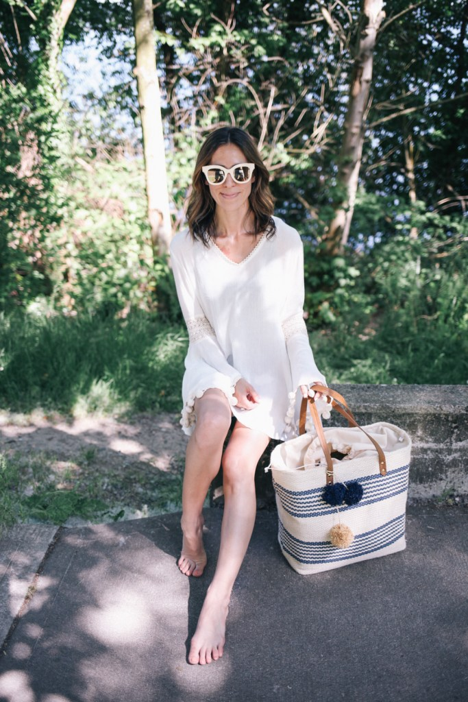 Blogger Mary Krosnjar wearing white beach cover-up in Seattle