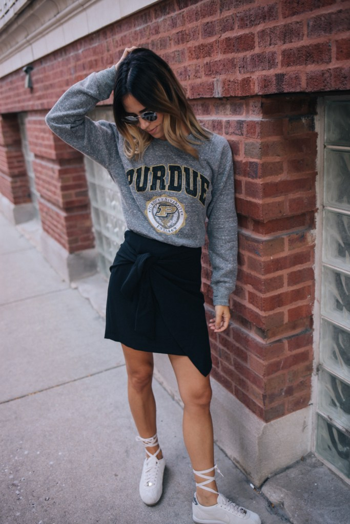Blogger Mary Krosnjar styling Who What Wear women's tie skirt and Nike A.L.C sneakers