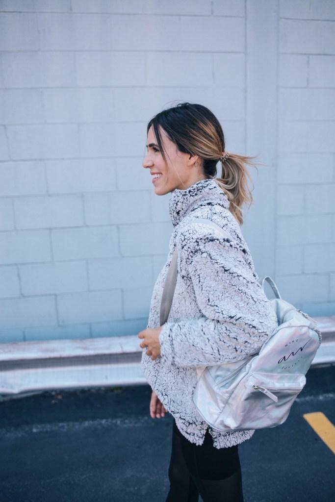 Blogger Mary Krosnjar wearing Sherpa Fleece Pullover and Mesh spandex pants