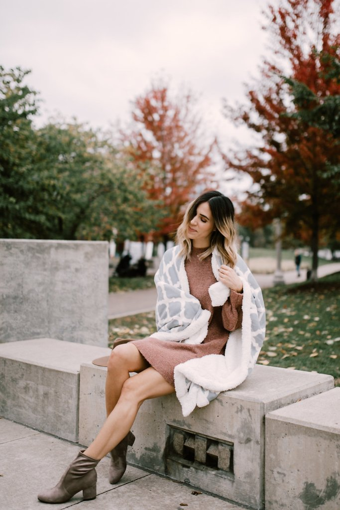 Blogger Mary Krosnjar with DSW Fleece Blanket and Women's Myllo Bootie