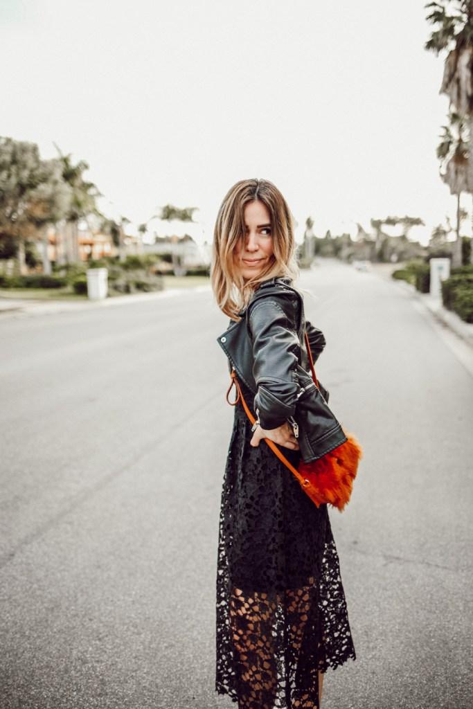 Blogger Mary Krosnjar wearing Elaine Faux Fur Clutch