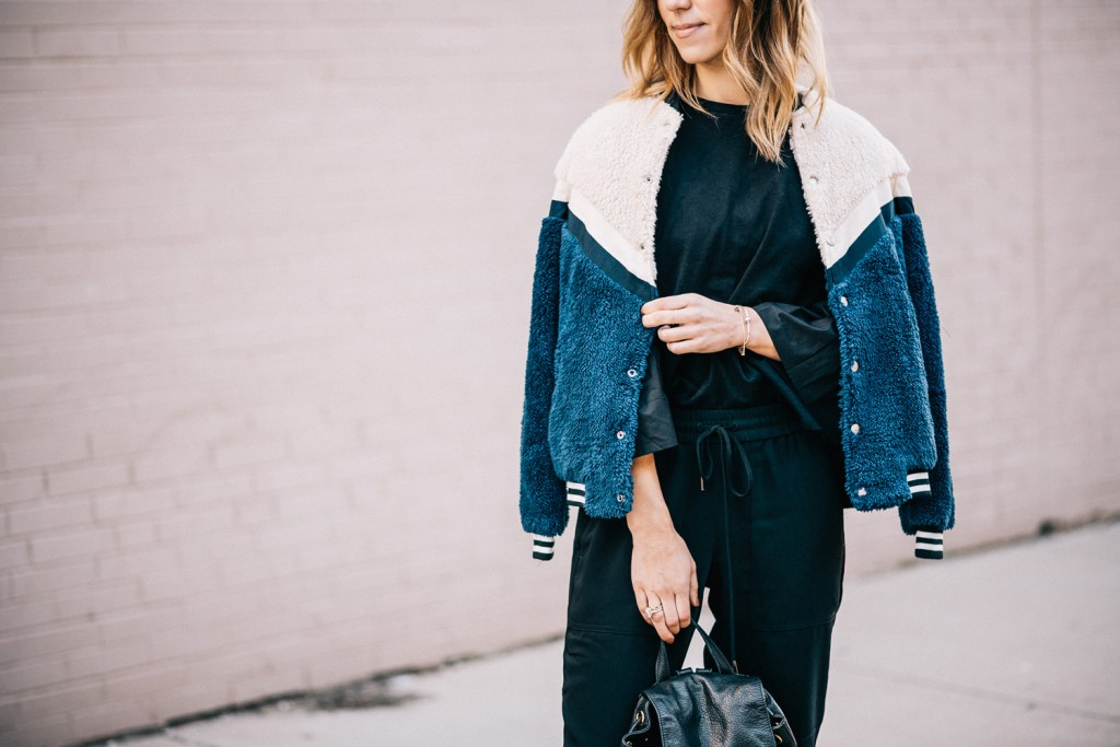 Blogger Mary Krosnjar wearing Weekend Casual and Travel Look with Teddy Bomber Jacket