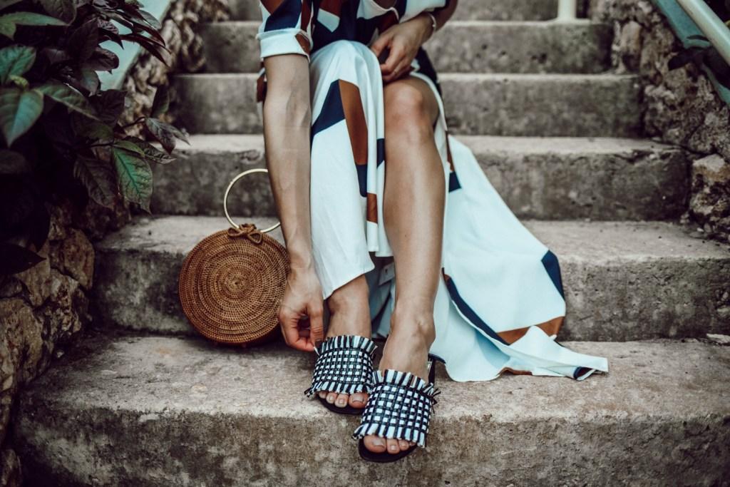 Blogger Mary Krosnjar wearing Geometric Print Split Maxi Dress and Woven H&M Mules