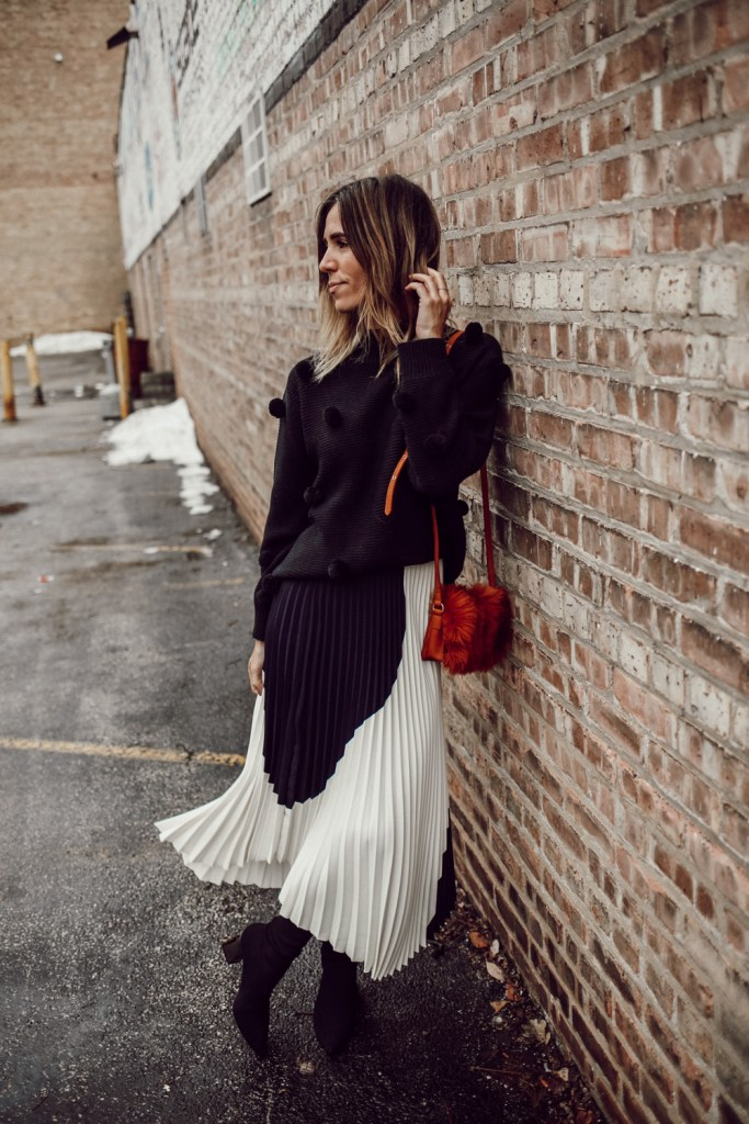 Rachel Parcell Black Pom Pom Sweater and H&M pleated skirt