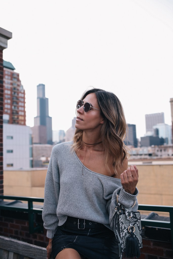 Blogger Mary Krosnjar wearing off-the-shoulder sweater