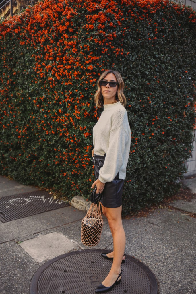 Blogger Mary Krosnjar wearing Balloon Sleeve Sweater and Topshop Faux Mini Skirt