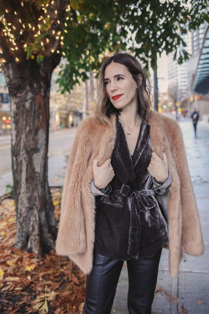 Blogger Sportsanista wearing Faux Fur Coat and Stila Lipstick Besos