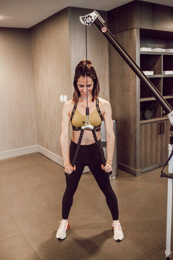 Blogger Sportsanista wearing NIKE Women's Dri-FIT Indy Logo Sports Bra and Nike Air Max 270