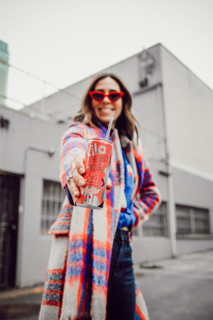 Blogger Sportsanista sharing Super Bowl Party Essentials and Lila Wine Cans