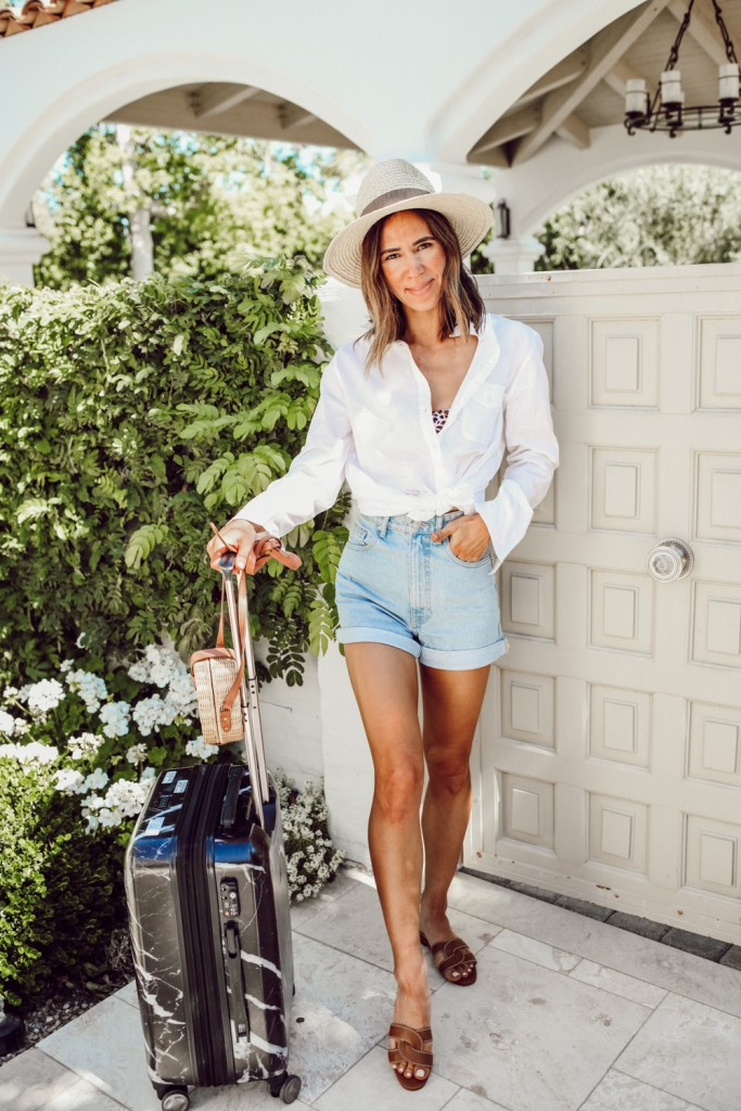 Seattle Fashion Blogger Sportsanista wearing J.Crew white button-up, H&M high waisted short and Calpak Marble Luggage