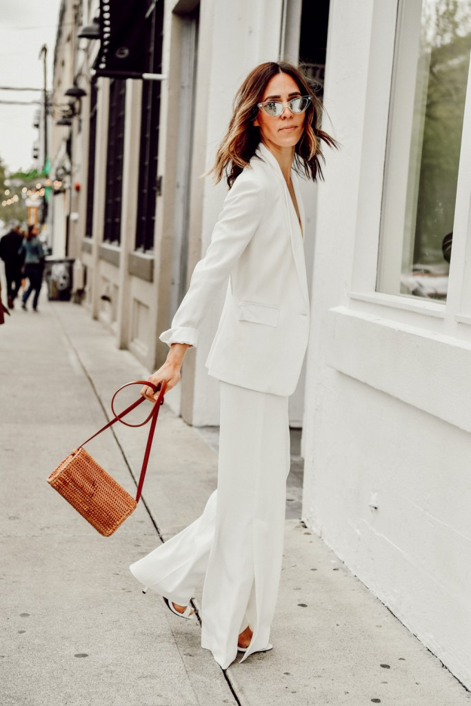 Seattle Fashion Blogger Sportsanista wearing white blazer and white wide leg pants for summer workwear look