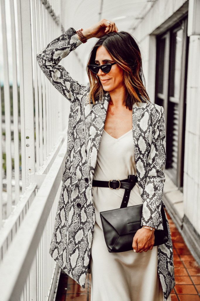 Seattle Fashion Blogger Sportsanista wearing animal print Mural Snakeskin Faux Leather Jacket and $10 Cat Eye Sunglasses on Smith Tower