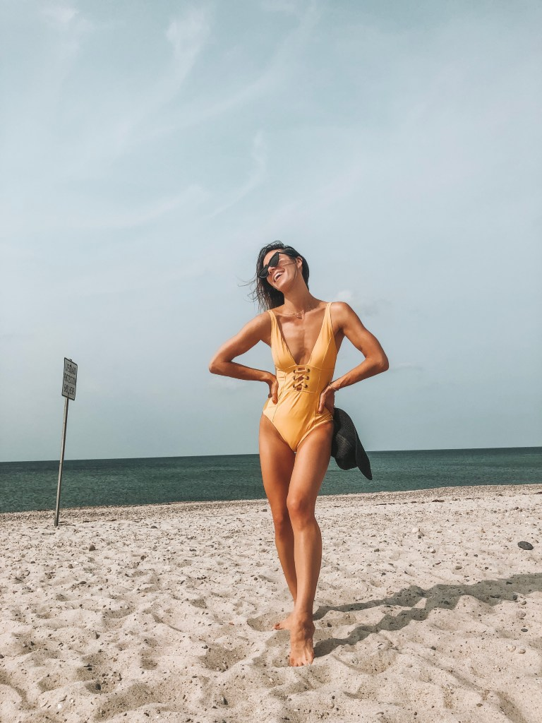 Seattle Fashion Blogger Sportsanista wearing yellow bathing suit at Sandy Neck Beach