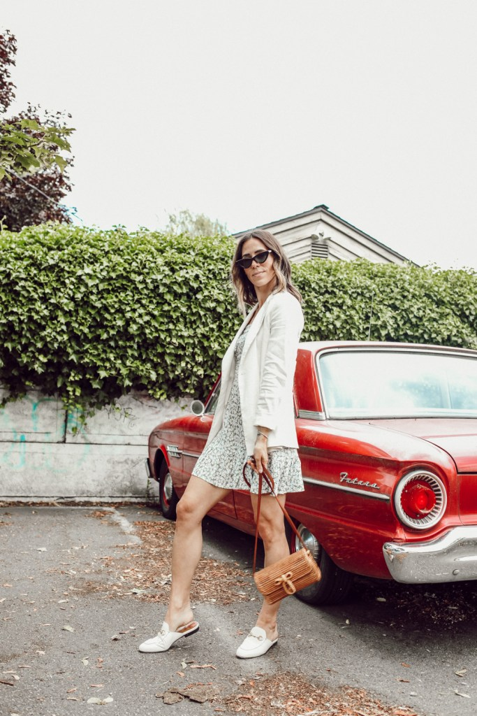 Seattle Fashion Blogger styling a white oversized blazer, floral dress and wicker bag for summer