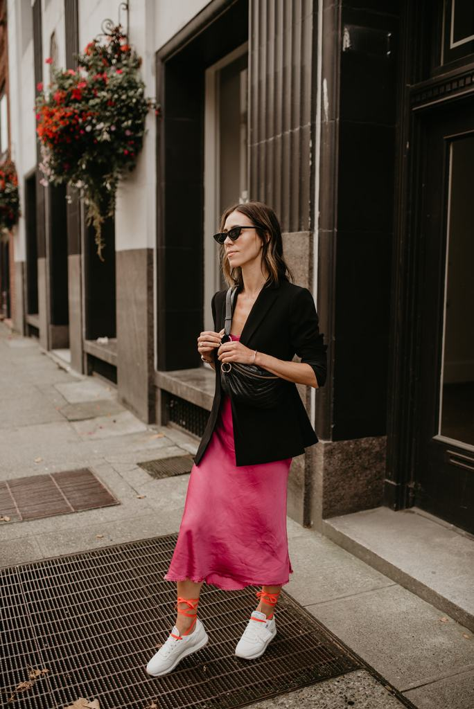 Seattle Blogger Sportsanista sharing how to style a dress with sneakers for fall