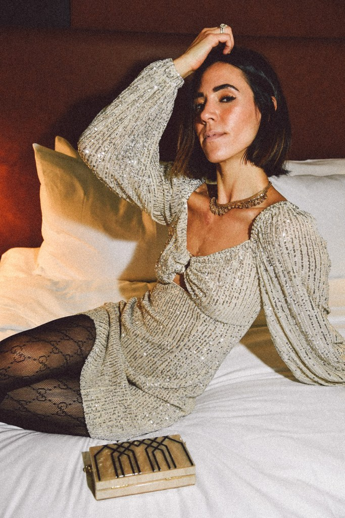 Blogger Mary Krosnjar wearing Lustre Long Sleeve Sequin Mini Dress and Gucci Tights