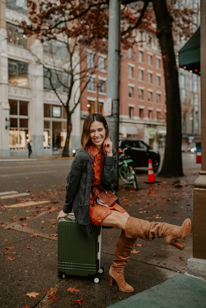 Blogger Mary Krosnjar wearing Who What Wear Faux Leather Dress and J.Crew Oversized Cardigan with Tall Suede Brown Boots