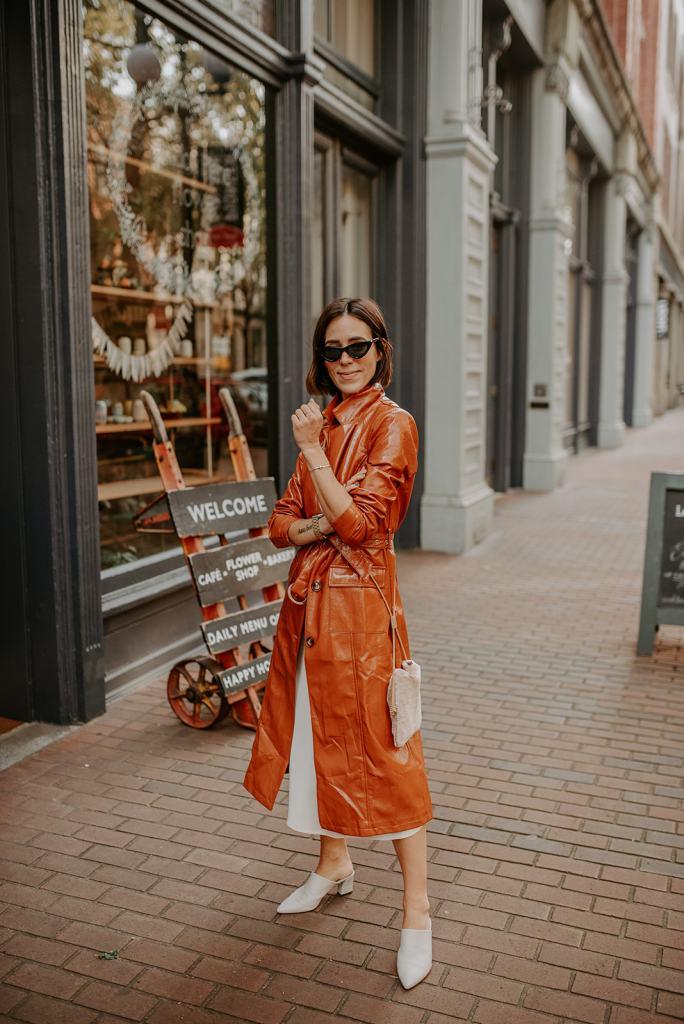 Blogger Mary Krosnjar wearing Vinyl Trench Coat and Cream Slip Dress