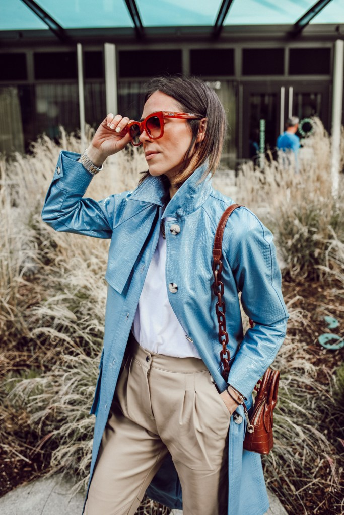 Seattle Blogger Mary Krosnjar wearing Blue Faux Leather Trench Coat and Quay Sunglasses