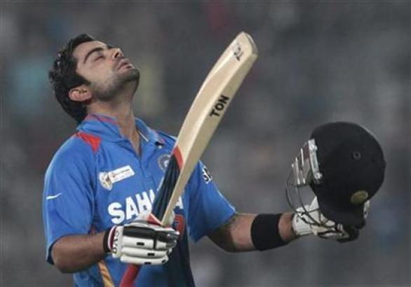 Virat Kohli walks off the field after being dismissed during their Asia Cup One Day International (ODI) cricket match against Pakistan in Dhaka March 18, 2012. REUTERS/Andrew Biraj