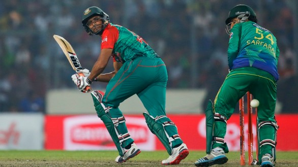 Bangladesh's Mahmudullah, left, plays a shot during the Asia Cup Twenty20 international cricket match against Pakistan in Dhaka, Bangladesh, Wednesday, March 2, 2016. (AP Photo/A.M. Ahad)