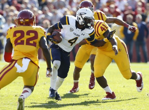 TJ Mutcherson (#22) goes to tackle Corey Jones of Toledo (David Purdy/Getty Images North America)