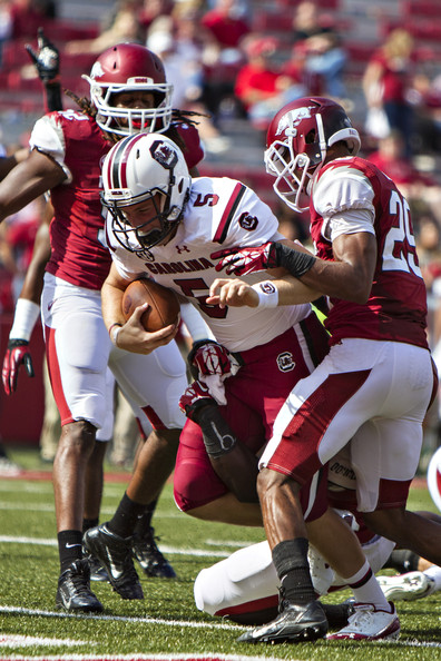 Quarterback Brendan Nosovitch rushes for a touchdown against Arkansas in 2013 (Wesley Hitt/Getty Images North America)