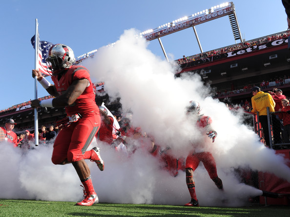 L.J. Liston leading Rutgers out of the tunnel against Temple in 2013 (Maddie Meyer/Getty Images North America)
