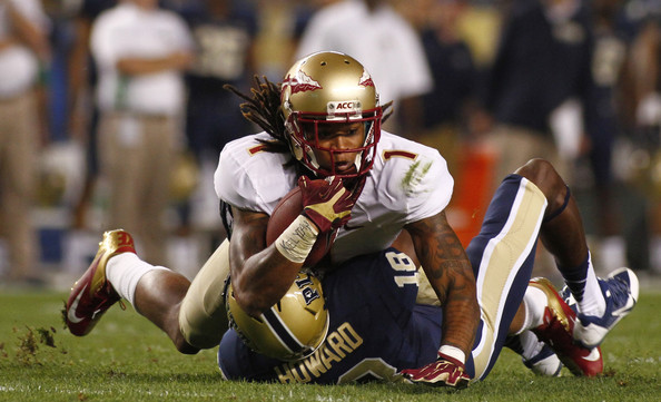 Defensive back Titus Howard makes a tackle against Florida State in 2013 (Justin K. Aller/Getty Images North America)